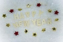 Happy New Year lying in the snow Royalty Free Stock Photo