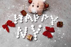 Happy new year 2019 made of berries, pig toy and christmas decoration. Bows, gifts stock photography