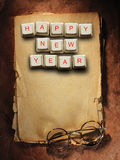 Happy New Year made of computer keys and glasses, background Stock Photo