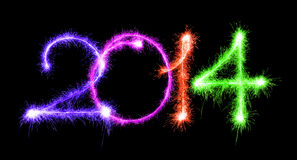 Happy New Year - 2014 made a sparkler different colors on a blac Royalty Free Stock Photos