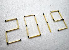 Happy new year 2019 with match sticks. New year 2019, made with the match sticks on a textured white background stock photos