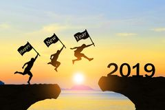 Happy New Year 2019 Men jump over silhouette. Mountains and sun royalty free stock photos