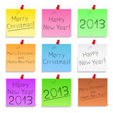 Happy New Year and Merry Christmas. Sticky notes with Happy New Year and Merry Christmas text Royalty Free Stock Photography