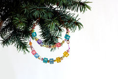 Happy New Year and merry Christmas card beaded letter garland on fir tree brunch Stock Image