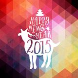Happy New Year and Merry Christmas design, geometric backdrop. typography composition with lettering. Goat silhouette 2015. Triang Royalty Free Stock Photos