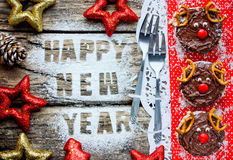 Happy New Year and Merry Christmas food background with greeting. Text festive decorations and cake deer top view Stock Photography