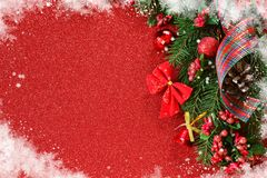 Happy New Year and Merry Christmas. New Year red background. With spruce and decorations of balls and snowflakes stock photo