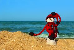 Happy New Year and Merry Christmas Traveling Destinations, Tropical Vacations Concept. Christmas, Traveling, Holidays Concept.Snowman In Red Clothes Standing On Royalty Free Stock Images