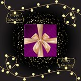 Happy New Year and Merry Christmas velvet gift box with golden b Royalty Free Stock Images