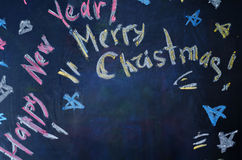 Happy new year and merry Christmas written with chalk Stock Images