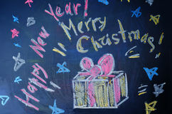 Happy new year and merry Christmas written with chalk Royalty Free Stock Photography