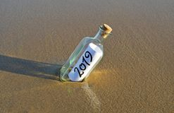 Happy New Year 2019, message in a bottle stock photos