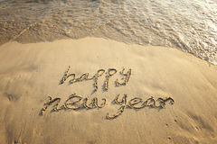 Happy new year message on the sand. Beach rn royalty free illustration