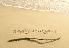 Happy new year message on the sand Royalty Free Stock Images