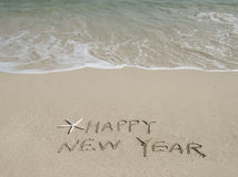 Happy new year message on the sand Royalty Free Stock Photography