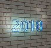 2018 happy new year neon sign on a white brick wall 3d render.  Royalty Free Stock Photography