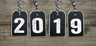 Happy New Year New Years Eve 2019 Change Changes. The New Year changes everything. Black wooden tags with 2019. Happy New Year New Years Eve 2019 Change Changes stock photography