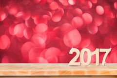 Happy New Year 2017 number in perspective room with red sparklin. G bokeh lights and wooden plank floor,leave space for adding content Royalty Free Stock Photo