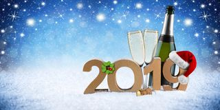 Happy new year 2019 number with santa hat four leaf clover champ. Agne bottle glass in front of blue snow night sky panorama background royalty free stock photography