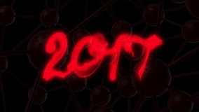 Happy new year 2017  numbers lettering written with fire flame or smoke on black background.  Royalty Free Stock Photos