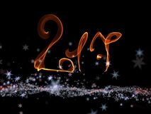 Happy new year 2017  numbers lettering written with fire flame or smoke on black background.  Stock Photo