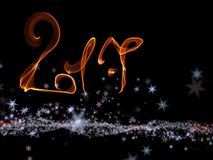Happy new year 2017  numbers lettering written with fire flame or smoke on black background.  Royalty Free Stock Image