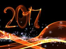 Happy new year 2017  numbers lettering written with fire flame or smoke on black background.  Stock Photos