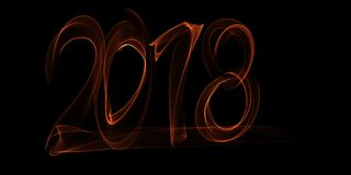 Happy new year 2018  numbers lettering written with fire flame or smoke on black background.  Stock Images