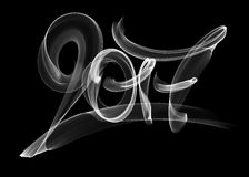 Happy new year 2017  numbers lettering written with white fire flame or smoke on black background.  Royalty Free Stock Image