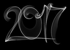 Happy new year 2017  numbers lettering written with white fire flame or smoke on black background.  Stock Image