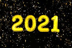 2021 Happy New Year numbers text, confetti on black background. Christmas party greeting decor