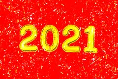 2021 Happy New Year numbers text, confetti on red background. Christmas party greeting decor