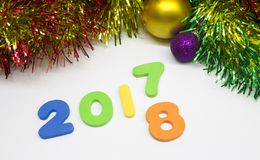 Happy new year numeral 2017 2018 decoration background. Happy new year numeral 2017 2018 tinsel and balls decoration background Stock Image