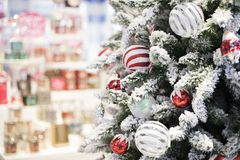Happy new year and ornaments on the Christmas tree with gift box. Blurred and soft focus Royalty Free Stock Photo