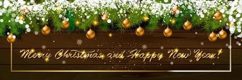 Happy New Year, panoramic banner. Golden text happy new year Golden text happy new year wooden background balls Christmas tree branches background balls Stock Photo