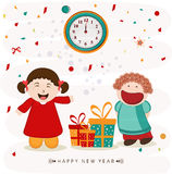 Happy New Year party celebrations concept. Cute little girls pointing to the clock and showing time for Happy New Year party celebration with gifts on stylish Royalty Free Stock Image