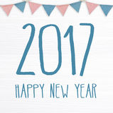 Happy new year 2017 and party flags hanging on white wood backgr. Ound, banner Royalty Free Stock Images