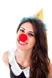 Happy new year. Party time. Happy girl with party hat and red nose as clown. Cute female celebrating with seductive look at camera. Portrait, isolated on white Stock Image