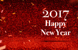 Happy new year 2017 at perspective red sparkling glitter with go. Ld confetti,Holiday greeting card design Royalty Free Stock Photos