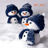 Happy new year PF 2017 with three snowmen - color white and blue. Happy new year PF 2016 with three handmade snowmen - color white and blue Royalty Free Stock Photo