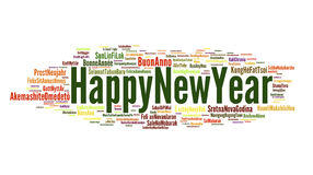 Happy New Year. The phrase Happy New Year in different languages with the more widely spoken in bigger fonts, in white background Royalty Free Stock Photos