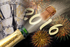 Happy new year 2016 with popping champagne. And clock at midnight Stock Photos
