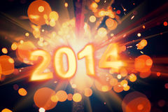 Happy new year 2014. Poster with bright sparkler explosion Stock Images