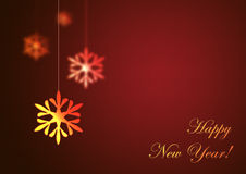 Happy New Year on red background. Christmas snowflake hanging on red background. Happy New Year Stock Photos