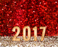 Happy New 2017 year in red and gold glitter background, Holiday. Concept design,leave space for adding your content Royalty Free Stock Images