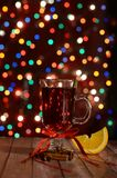 Happy New Year 2018 ,red mulled wine. Happy New Year 2018 , warming hot red mulled wine  on backgroung bokeh Stock Image