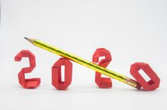 Happy New Year 2020 with red numbers and pencile