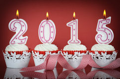 Happy New Year for 2015 red velvet cupcakes Stock Photos