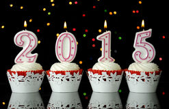 Happy New Year for 2015 red velvet cupcakes Royalty Free Stock Photography