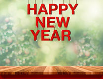 Happy new year red wood word hanging over marble table top with Royalty Free Stock Images